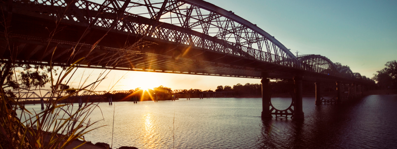 Burnett traffic bridge over burnett river at sunset