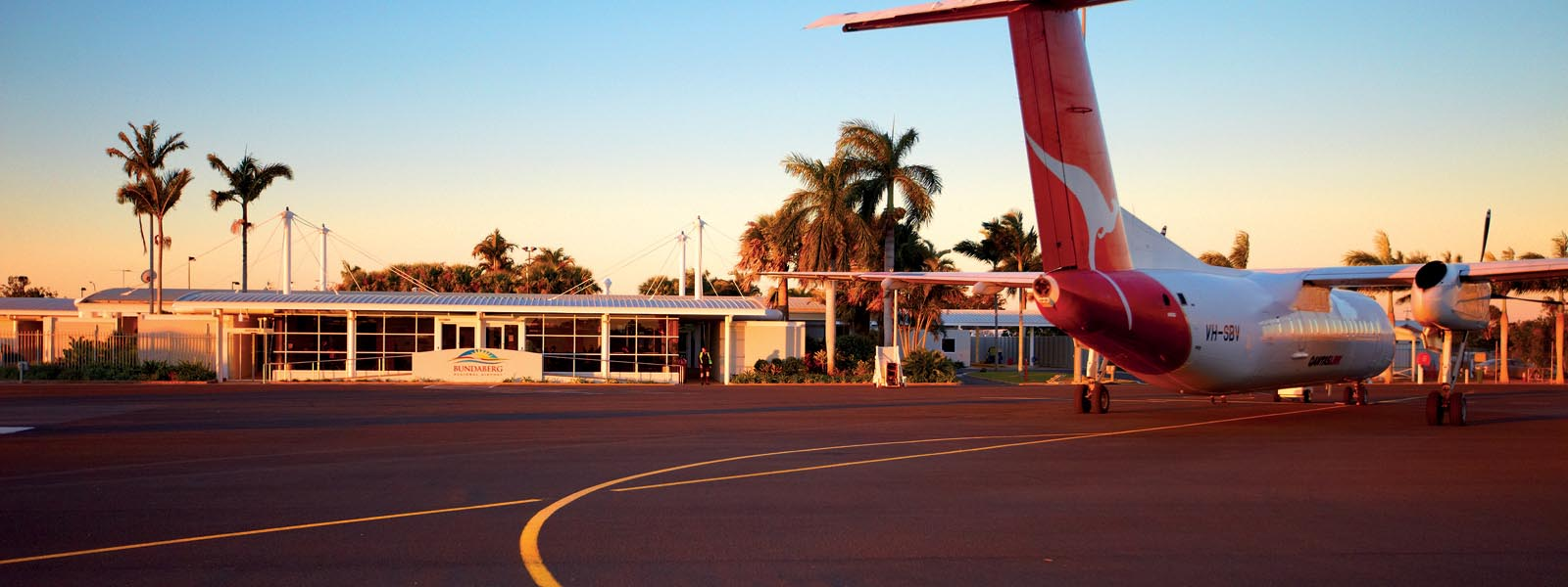 Qantas plane at bundaberg airport at sunset