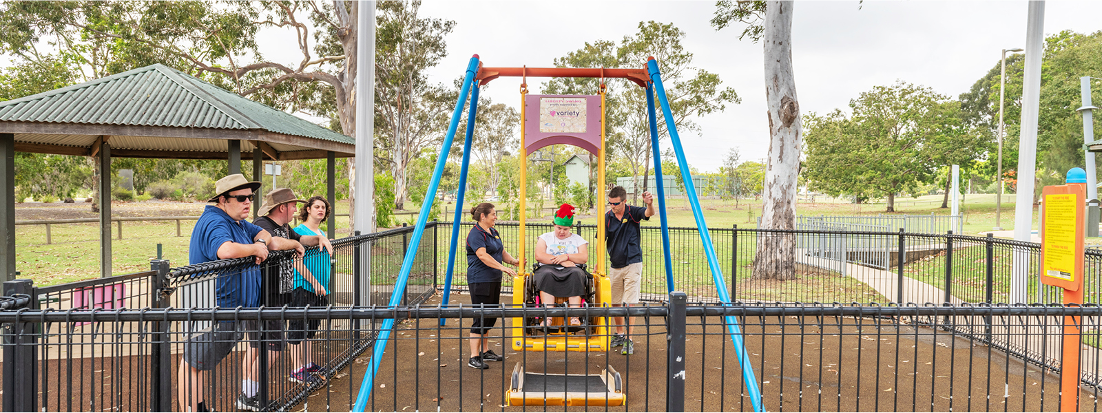 Residents enjoying the all abilities liberty swing