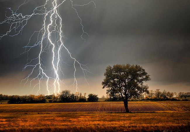 Lightning strike in middle of a field